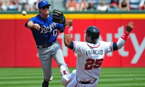 Chris Getz of the Kansas City Royals turns a double play against Atlanta's Juan Francisco