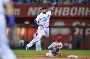 May 22, 2015; Kansas City, MO, USA; Kansas City Royals second basemen Omar Infante (14) attempts a throw to first over St. Louis Cardinals base runner Peter Bourjos (8) during the seventh inning at Kauffman Stadium. Mandatory Credit: Peter G. Aiken-USA TODAY Sports