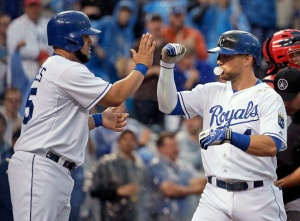 Kansas City Royals' Alex Gordon, right, celebrates with Kendrys Morales after Gordon hit a two-run home run during the second inning of a baseball game against the St. Louis Cardinals on Saturday, May 23, 2015, in Kansas City, Mo. (AP Photo/Charlie Riedel)
