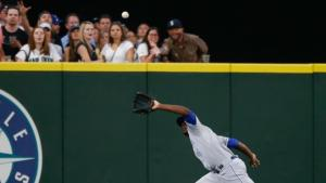SEATTLE, WA - JUNE 23:  Center fielder Lorenzo Cain #6 of the Kansas City Royals makes a running catch on a ball off the bat of Dustin Ackley of the Seattle Mariners in the seventh inning at Safeco Field on June 23, 2015 in Seattle, Washington.  (Photo by Otto Greule Jr/Getty Images)