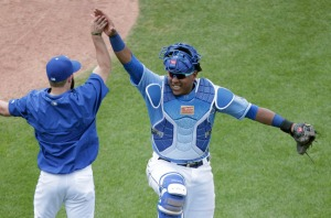 Kansas City Royals' Salvador Perez, right, celebrates with a teammate after a baseball game against the Texas Rangers, Sunday, June 7, 2015, in Kansas City, Mo. The Royals won 4-3. (AP Photo/Charlie Riedel)
