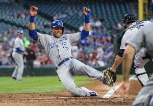 Kansas City's Alex Rios beats the throw home to Seattle catcher Mike Zunino, scoring on the bases-clearing 3-run RBI double by Omar Infante.  Kansas City scored 7-runs in the inning.   The Kansas City Royals played the Seattle Mariners Wednesday, June 24, 2015, at Safeco Field in Seattle.