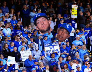 KANSAS CITY, MO - OCTOBER 15:  Kansas City Royals Fans hold up giant heads of Alex Gordon #4 and Salvador Perez #13 of the Kansas City Royals in the stands during Game Four of the American League Championship Series against the Baltimore Orioles at Kauffman Stadium on October 15, 2014 in Kansas City, Missouri.  (Photo by Jamie Squire/Getty Images)