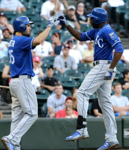 Kansas City Royals' Lorenzo Cain, right, celebrates with teammate Eric Hosmer after hitting a solo home run during the 13th inning of a baseball game against the Chicago White Sox, Saturday, July 18, 2015, in Chicago. The Royals won 7-6. (AP Photo/Nam Y. Huh)