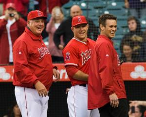 Angels manager Mike Scioscia and team general manager Jerry Dipoto stand with Mike Trout as he recieves the 2012 Rookie of the Year honor at Angel Stadium Saturday night. Trout was the second Angel to get the honor since Tim Salmon in 1993. ///ADDITIONAL INFO: hsmaya.0413 - 4/13/13 - ROD VEAL, ORANGE COUNTY REGISTER - The Angels take on the Houston Astros at Angel Stadium Saturday night.
