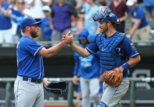 CHICAGO, IL - JULY 17:  Greg Holland #56 of the Kansas City Royals (L) is congratulated by Drew Butera #9 after a win over the Chicago White Sox at U.S. Cellular Field on July 17, 2015 in Chicago, Illinois. The Royals defeated the White Sox 4-2.  (Photo by Jonathan Daniel/Getty Images)