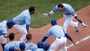 Kansas City Royals' Paulo Orlando, right, celebrates with teammates after hitting a walk-off grand slam during the ninth inning of the first game in a baseball doubleheader against the Tampa Bay Rays Tuesday, July 7, 2015, in Kansas City, Mo. The Royals won 9-5. (AP Photo/Charlie Riedel)