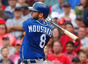 Kansas City Royals' Mike Moustakas follows through on a two-run double against the Boston Red Sox during the ninth inning of a baseball game at Fenway Park in Boston Sunday, Aug. 23, 2015. (AP Photo/Winslow Townson)