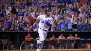 KANSAS CITY, MO - AUGUST 14: Eric Hosmer #35 of the Kansas City Royals runs to first hatter hitting a two-run home run against the Los Angeles Angels of Anaheim in the sixth inning at Kauffman Stadium on August 14, 2015 in Kansas City, Missouri. (Photo by Ed Zurga/Getty Images) *** Local Caption *** Eric Hosmer