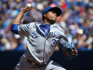 TORONTO, CANADA - AUGUST 2: Edinson Volquez #36 of the Kansas City Royals delivers a pitch in the first inning during MLB game action against the Toronto Blue Jays on August 2, 2015 at Rogers Centre in Toronto, Ontario, Canada. (Photo by Tom Szczerbowski/Getty Images)