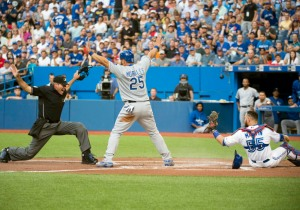 Jul 31, 2015; Toronto, Ontario, CAN; Home Plate umpire Angel Hernandez (55) calls Kansas City Royals designated hitter Kendrys Morales (25) safe at home plate during the first inning in a game against the Toronto Blue Jays at Rogers Centre. Mandatory Credit: Nick Turchiaro-USA TODAY Sports ORG XMIT: USATSI-216426 ORIG FILE ID:  20150731_ajw_bt2_047.jpg