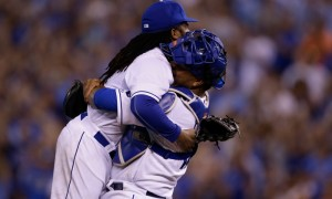 Kansas City Royals starting pitcher Johnny Cueto, left, is hugged by catcher Salvador Perez, right, following a baseball game against the Detroit Tigers at Kauffman Stadium in Kansas City, Mo., Monday, Aug. 10, 2015. The Royals defeated the Tigers 4-0. (AP Photo/Orlin Wagner) ORG XMIT: OTKOW