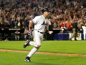 New York Mets Mike Piazza rounds the bases on his two-run home run in the eighth inning against the Atlanta Braves at Shea Stadium in New York, Friday, Sept. 21, 2001.  (AP Photo/Jeff Zelevansky)   Original Filename: BRAVES_METS_NYS216.jpg