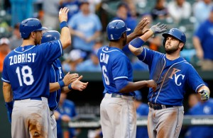 Kansas City Royals' Mike Moustakas, right, celebrates his grand slam with teammates Ben Zobrist (18), Kendrys Morales and Lorenzo Cain (6) in the seventh inning of a baseball game against the Baltimore Orioles, Saturday, Sept. 12, 2015, in Baltimore. (AP Photo/Patrick Semansky)