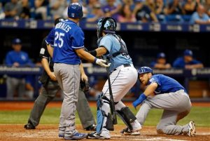 Tampa Bay Rays catcher Rene Rivera, second from right, tags out batter Kansas City Royals' Kendrys Morales (25) after tagging out Royals' Ben Zobrist, right, to complete a double play during the eighth inning of a baseball game Sunday, Aug. 30, 2015, in St. Petersburg, Fla. The Rays won 3-2. (AP Photo/Mike Carlson)