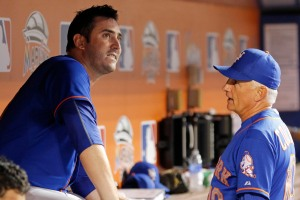 New York Mets starting pitcher Matt Harvey, left, speaks with manager Terry Collins in the dugout after he left the baseball game with the Miami Marlins in the eighth inning in Miami, Wednesday, Aug. 5, 2015. The Mets won 8-6. (AP Photo/Joe Skipper)