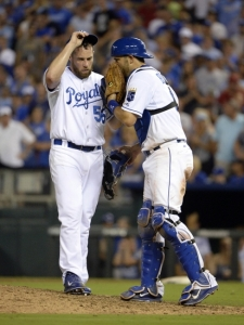 Aug 14, 2015; Kansas City, MO, USA; Kansas City Royals catcher Drew Butera (9) talks to relief pitcher Greg Holland (56) in the ninth inning against the Los Angeles Angels at Kauffman Stadium. Kansas City won the game 4-1. Mandatory Credit: John Rieger-USA TODAY Sports