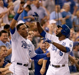 Kansas City Royals' Lorenzo Cain (6) celebrates with Salvador Perez after Cain hit a solo home run during the third inning of a baseball game against the Detroit Tigers Wednesday, Sept. 2, 2015, in Kansas City, Mo. (AP Photo/Charlie Riedel)