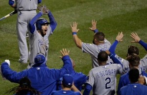 Kansas City Royals first baseman Eric Hosmer celebrates with his teammates after scoring during the ninth inning of Game 5 of the Major League Baseball World Series against the New York Mets Sunday, Nov. 1, 2015, in New York. (AP Photo/Julie Jacobson)