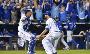 Oct 23, 2015; Kansas City, MO, USA; Kansas City Royals relief pitcher Wade Davis (17) and catcher Salvador Perez (left) celebrate after defeating the Toronto Blue Jays in game six of the ALCS at Kauffman Stadium. Mandatory Credit: Peter G. Aiken-USA TODAY Sports ORG XMIT: USATSI-245746 ORIG FILE ID: 20151023_jla_sa7_285.jpg